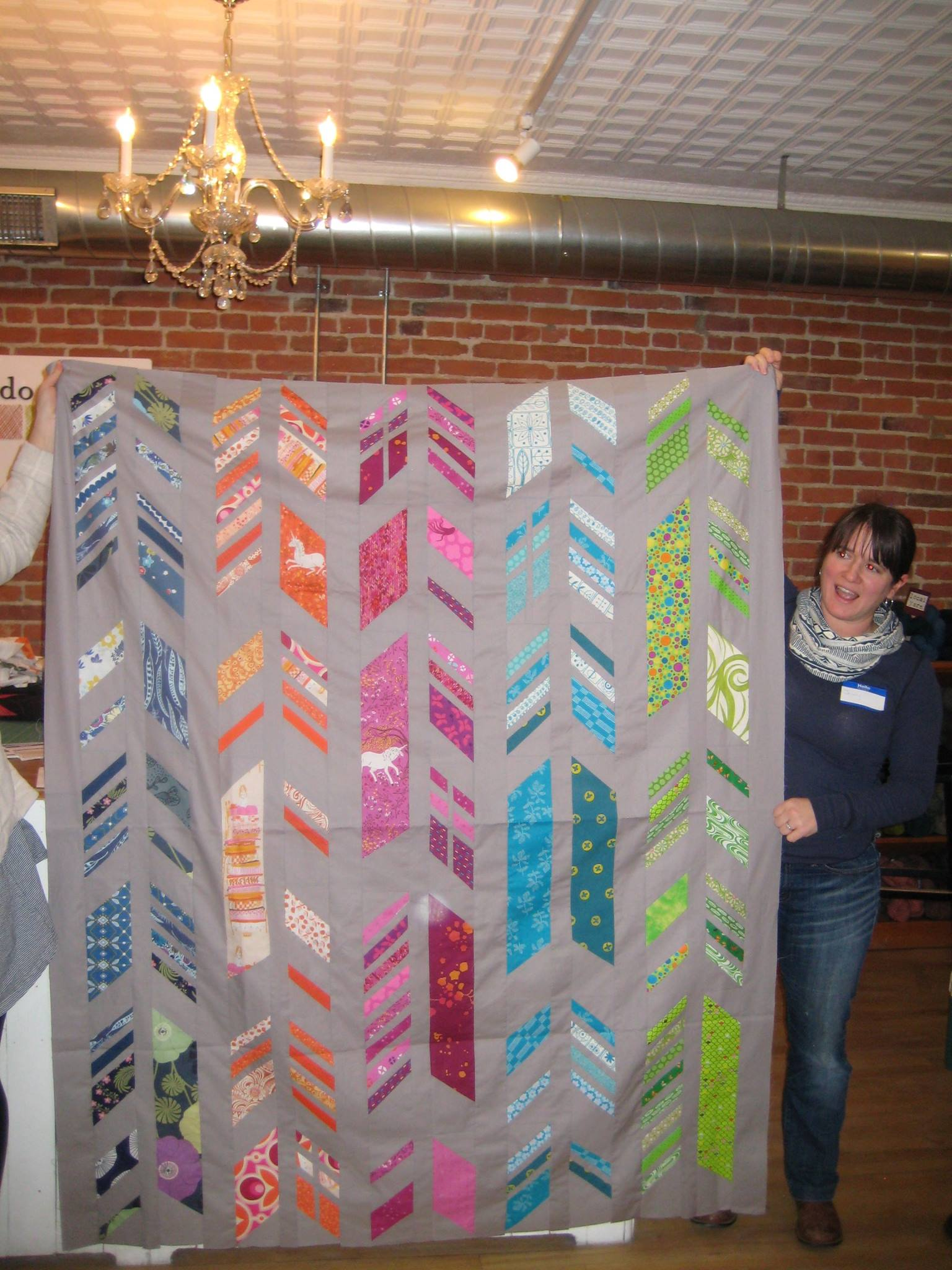 Jenny's Allison Glass feathers quilt is paper pieced.
