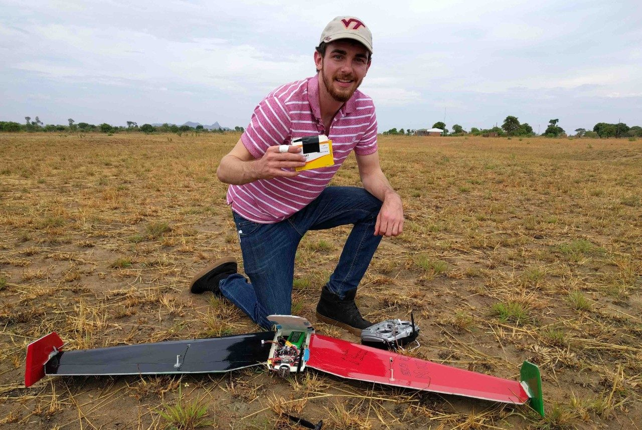 Zack Standridge, a graduate student with the Kevin T. Crofton Department of Aerospace and Ocean Engineering, holds the simulated medical package delivered by the autonomous drone.