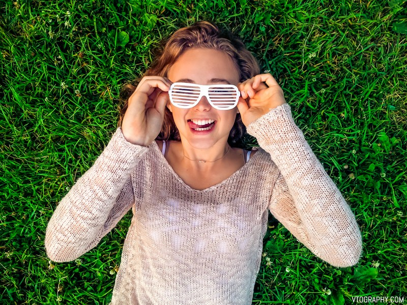 Kathryn wearing glasses in the grass