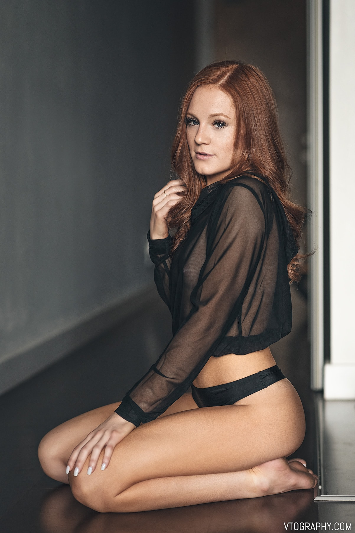 Redhead model Hannah in sheer black hoodie from Forever 21