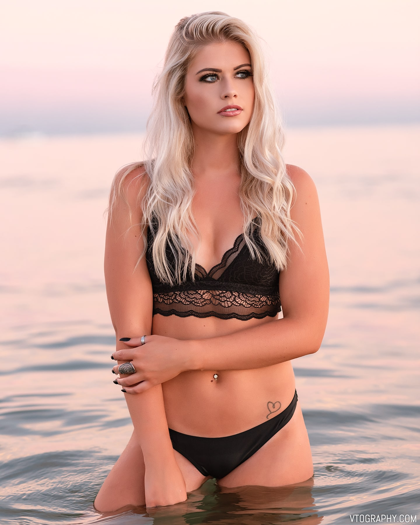 Sami in a bikini at sunset