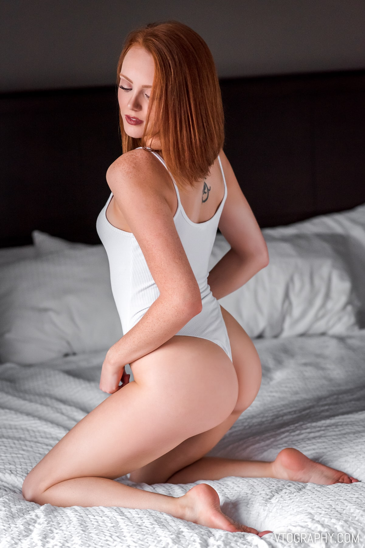 Red haired model Ashley in white bodysuit