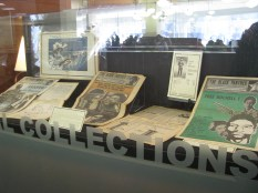 Exhibit case with Black Panther newspapers