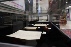 One of the display cases, including pictures, document, and artifacts from Special Collections.