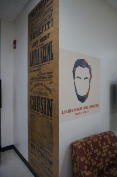 "Lincoln in Our Time Exhibit poster and ""Our American Cousin flyer. The 7 foot tall version of the flyer was made from a scan of an item in Special Collections."