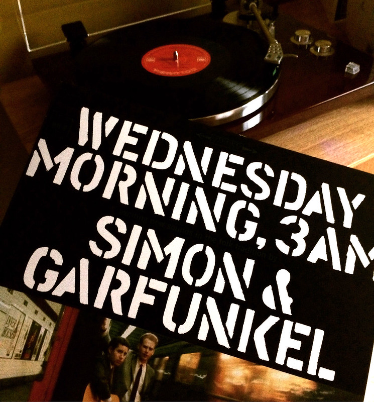 Simon and Garfunkels first album, 'Wednesday Morning, 3am' shown in front of a record player.