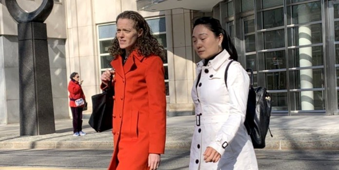 Former U.S.-based manager for Air China Lin Ying walking out of a federal building with an unidentified woman.