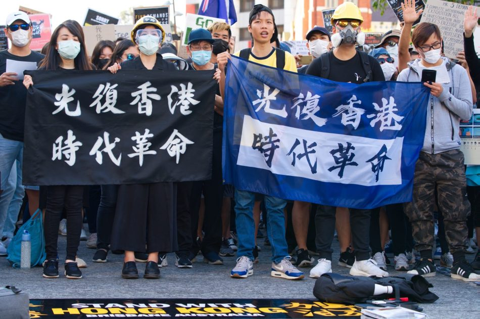 hong kong pro democracy generation y protesting, holding up a banner.