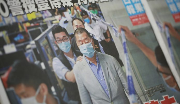 The cover of Hong Kong newspaper, Apple Daily, showing Jimmy Lai's arrest.