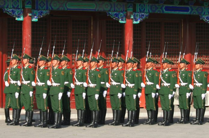 Soldiers of China's People's Liberation Army march in a parade.