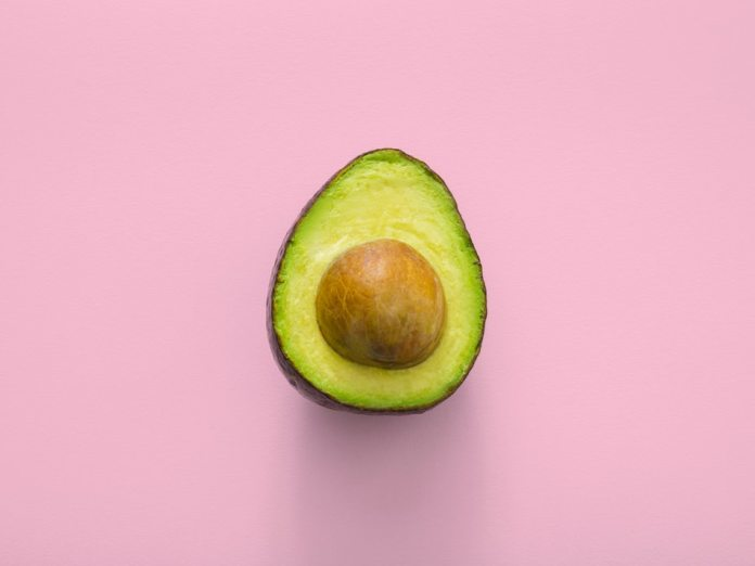 avocado for brain health on pink background