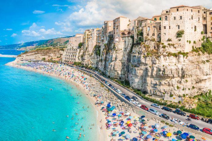 People enjoying the beach in Tropea, Italy.