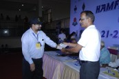 Technical Class license being handed over to OM Ariff VU3ARF by FCC Official