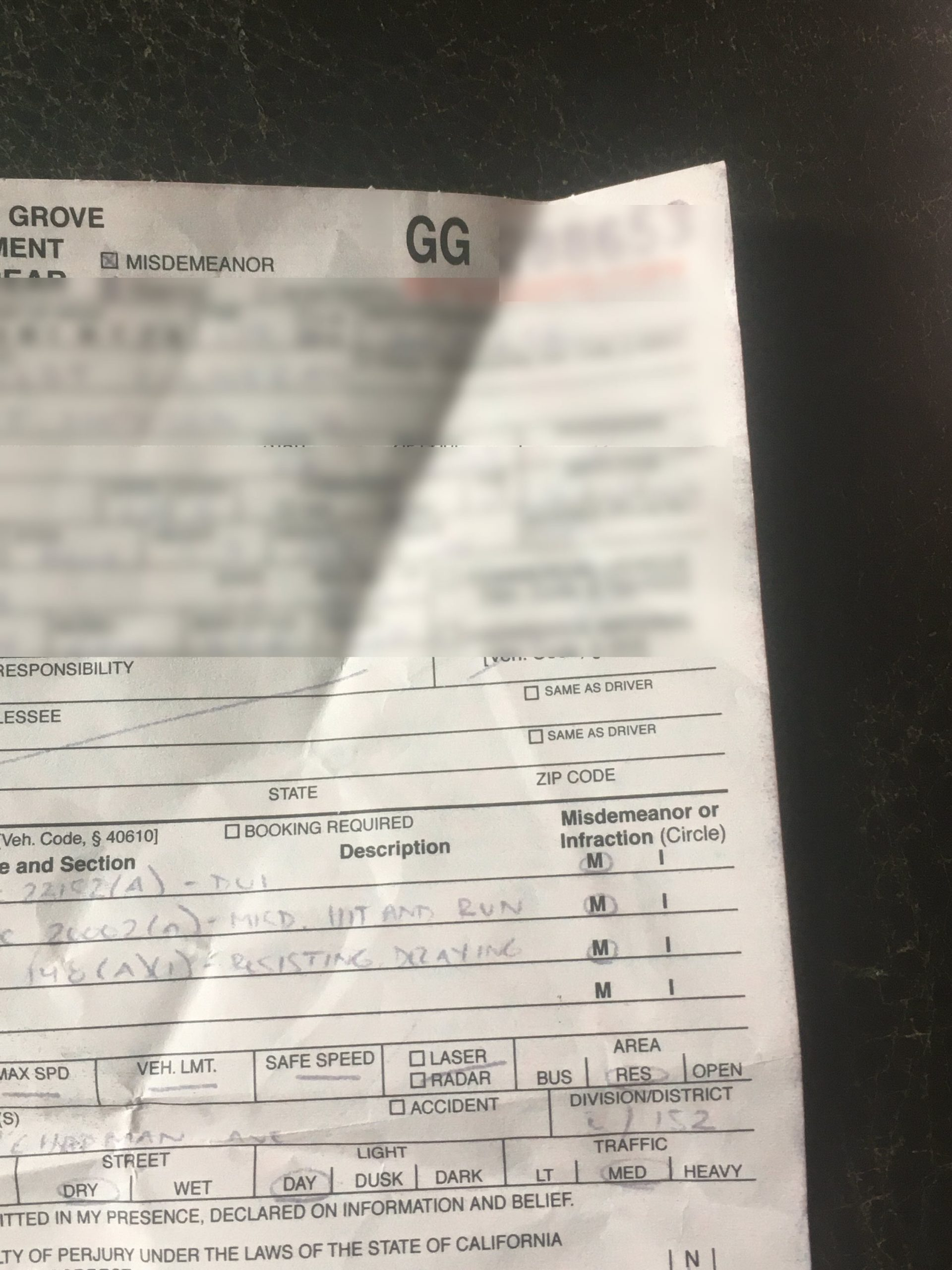 shows a citation by Garden Grove police department for a California Penal Code 148 arrest
