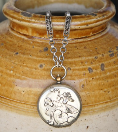 Necklace with pocket watch style pendant
