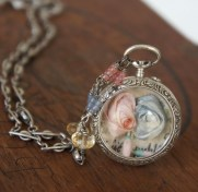 Necklace made with antique silf roses set into an antique silver watch case