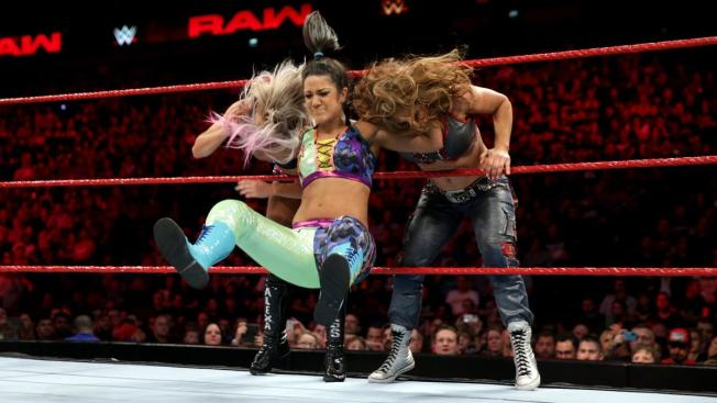Bayley bounces Mickie James and Alexa Bliss on the middle rope
