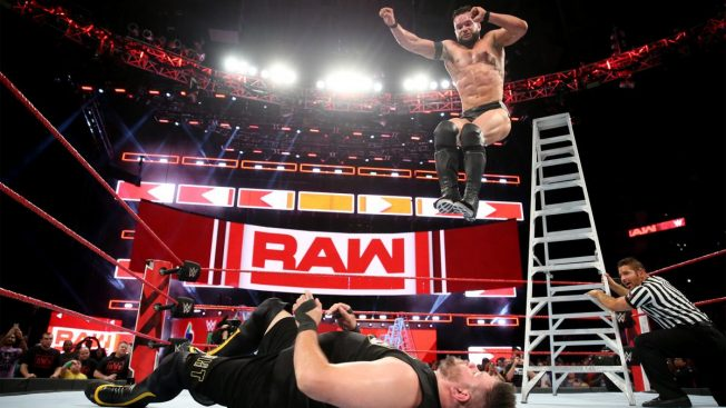 Finn Balor delivers Coup de Grace from a ladder to Kevin Owens