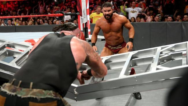 Braun Strowman breaks a ladder in front of Bobby Roode