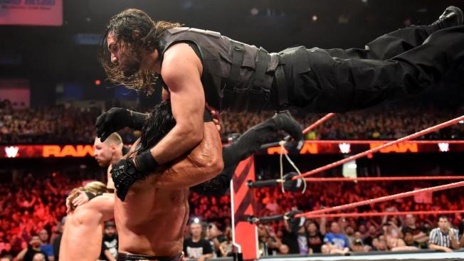 Seth Rollins and Dean Ambrose tandem suicide dives to Ziggle and McIntyre