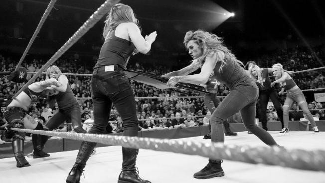 Becky Lynch hits Ronda Rousey with a chair