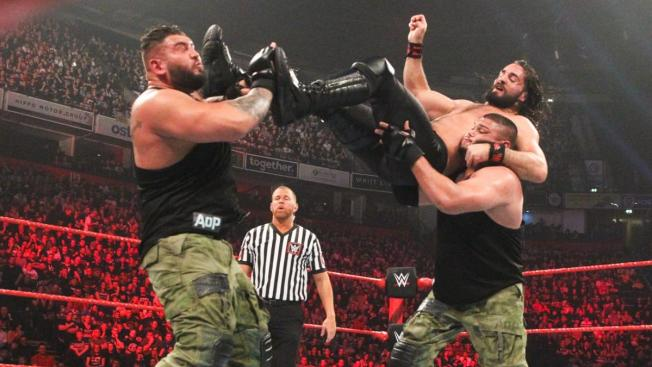 Seth Rollins is double teamed by AOP