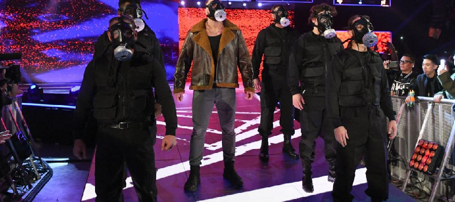 Dean Ambrose with swat team in gas masks