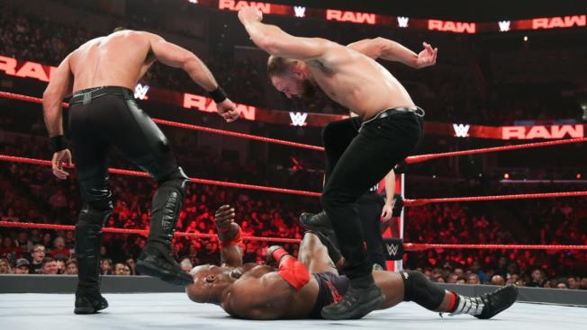 Seth Rollins and Dean Ambrose stamp on Bobby Lashley