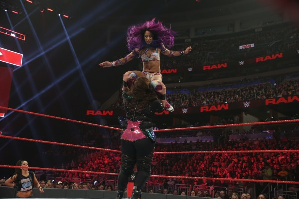 Sasha Banks delivers double knees from the top to Nia Jax