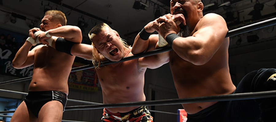 Suzuki and Iizuka bite Tenzan
