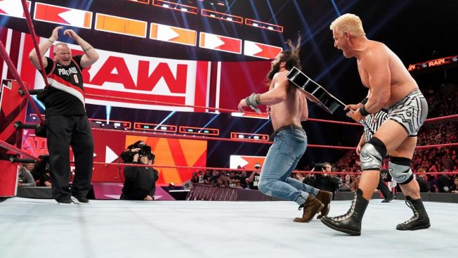 Road Dogg distracts Elias so Jeff Jarrett can hit him with a guitar