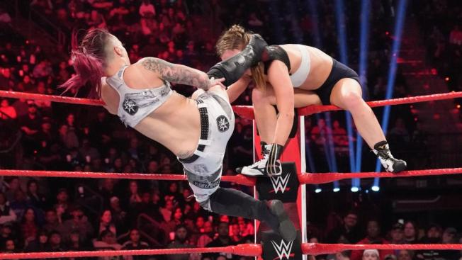 Ruby Riott kicks Ronda Rousey in the head