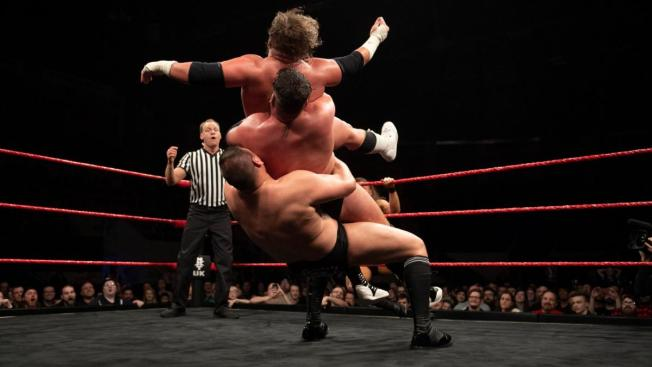Walter hits a German Suplex to both Coffey Brothers