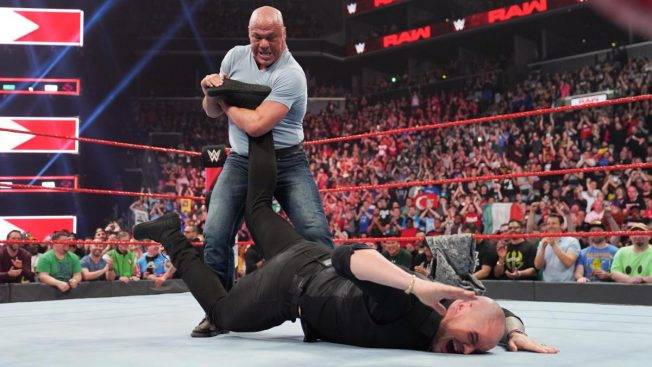 Kurt Angle with Baron Corbin in an ankle lock