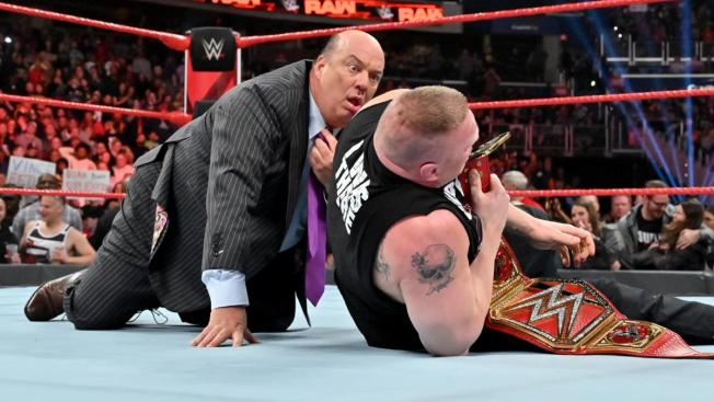Paul Heyman looks shocked after Rollins puts Lesnar down