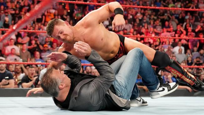 The Miz pounds on Shane McMahon