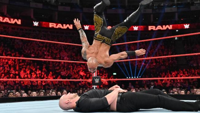Ricochet's shooting star press to Baron Corbin