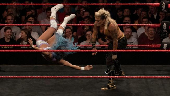 Jazzy throws Xia halfway across the ring
