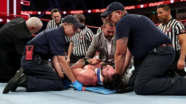 Seth Rollins is strapped to a backboard by medics