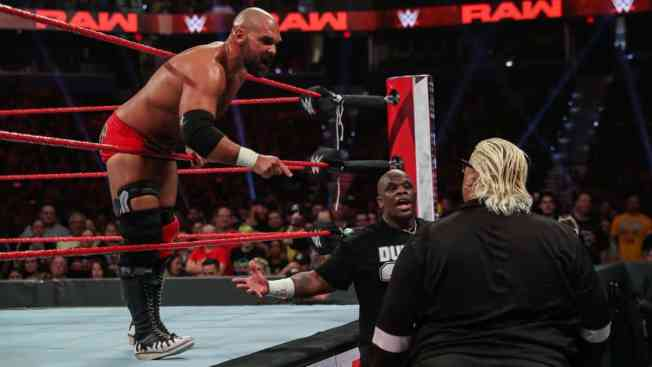 D-Von Dudley and Rikishi face to face while Scott Dawson yells