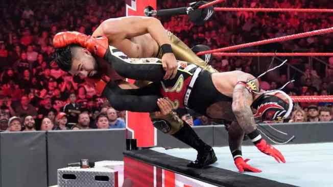 Rey Mysterio takes Andrade off the arpon