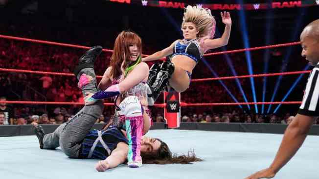 Alexa Bliss stops Kairi Sane pinning Nikki Cross