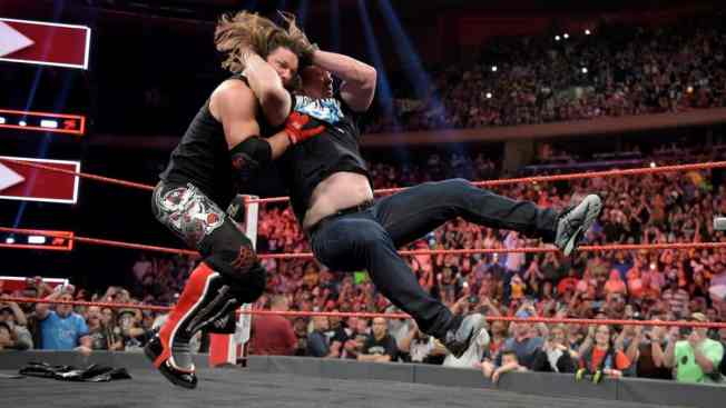 AJ Styles takes a Stone Cold Stunner