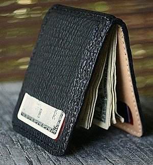 money-clip bi-fold wallet, black sharkskin open with card and money visible