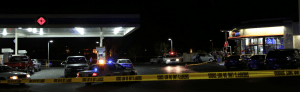 Customers were pumping gas and shopping inside at time of homicide.