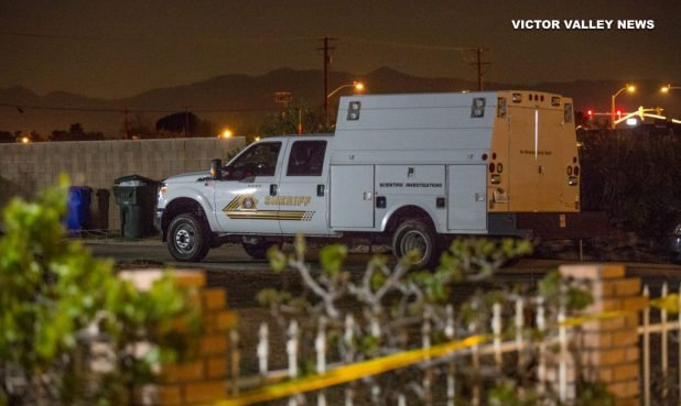 The scientific investigations truck remained parked in the driveway of the home at 10:30 p.m., 15 hours after the man was found dead. (Gabriel D. Espinoza, Victor Valley News)