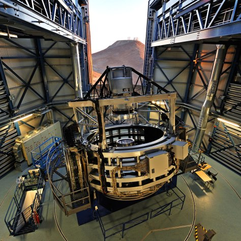 This spectacular view of the VISTA telescope was taken from the roof of the building during the opening of the enclosure at sunset. The VLT is visible on the neighbouring mountain. VISTA is the largest survey telescope in the world and it is dedicated to mapping the sky at near-infrared wavelengths. Its primary mirror is 4.1 metres in diameter and is the most highly curved of its size. The extremely high curvature reduces the focal length, making the structure of the telescope extremely compact. VISTA can map large areas of the sky quickly and deeply. #L