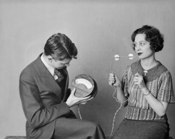 Man and Woman Examining Thermocouple