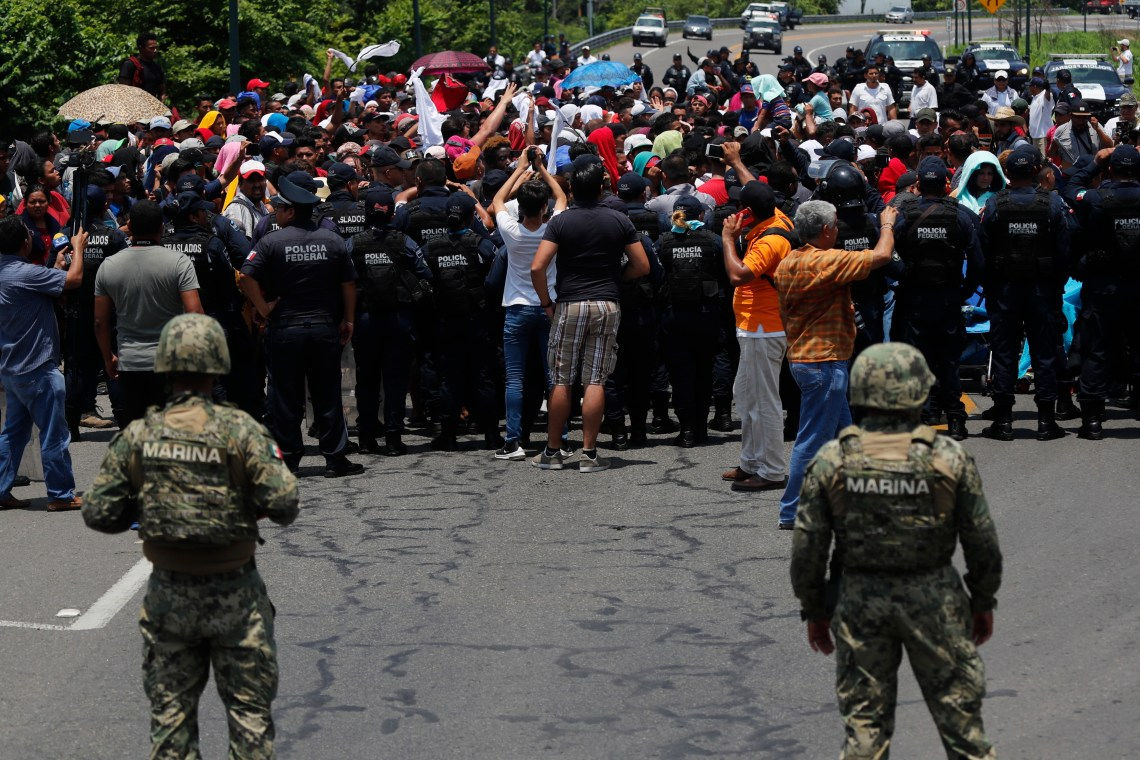 Mexican authorities stop a migrant caravan that had earlier crossed the Mexico-Guatemala border, near Metapa, Chiapas state, Mexico, June 5, 2019.