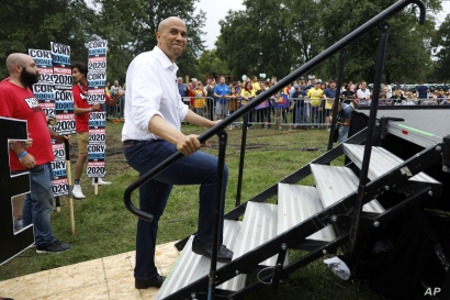 Democratic presidential candidate Sen. Cory Booker waits to speak at the Polk County Democrats Steak Fry, Saturday, Sept. 21, 2019, in Des Moines, Iowa. (AP Photo/Charlie Neibergall)